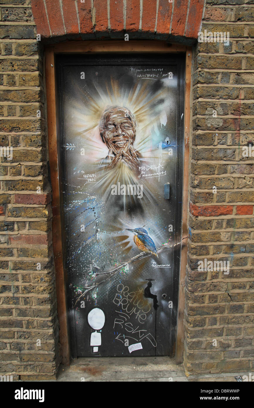 London 3 August 2013.  Portrait of 'Madiba' see on a doorway on Brick Lane in East London by street artist - Stock Image