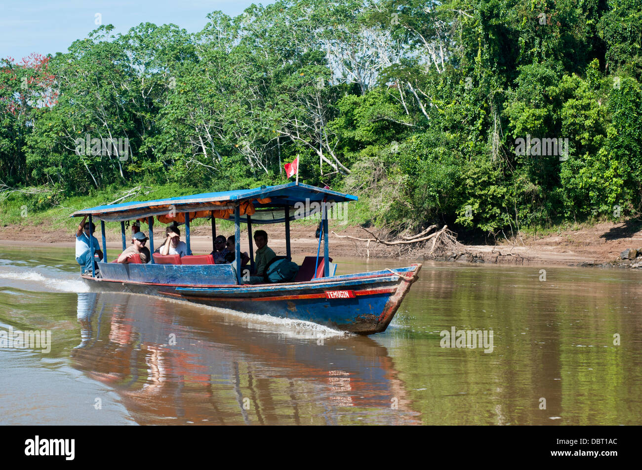 Peruvian riverboat transporting tourists on the Tambopata River near Puerto Maldonaldo Peru - Stock Image