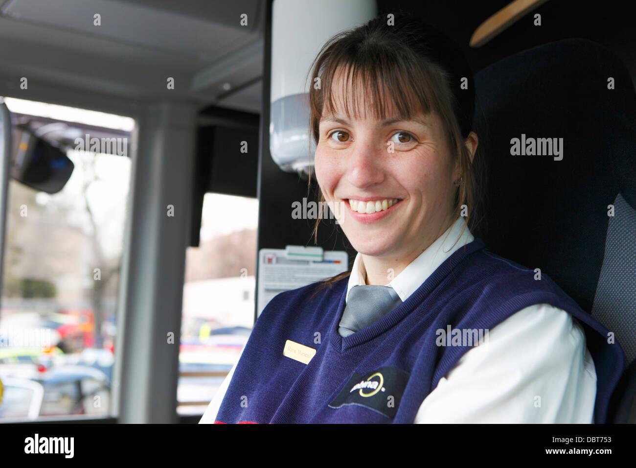 Portrait of female bus driver - Stock Image