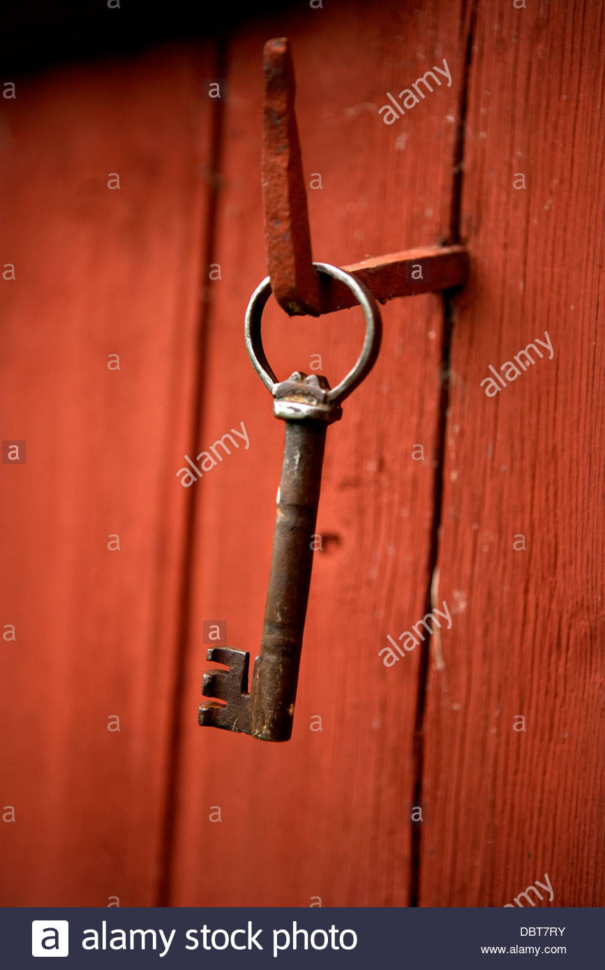 Close-up of key hanging on hook - Stock Image