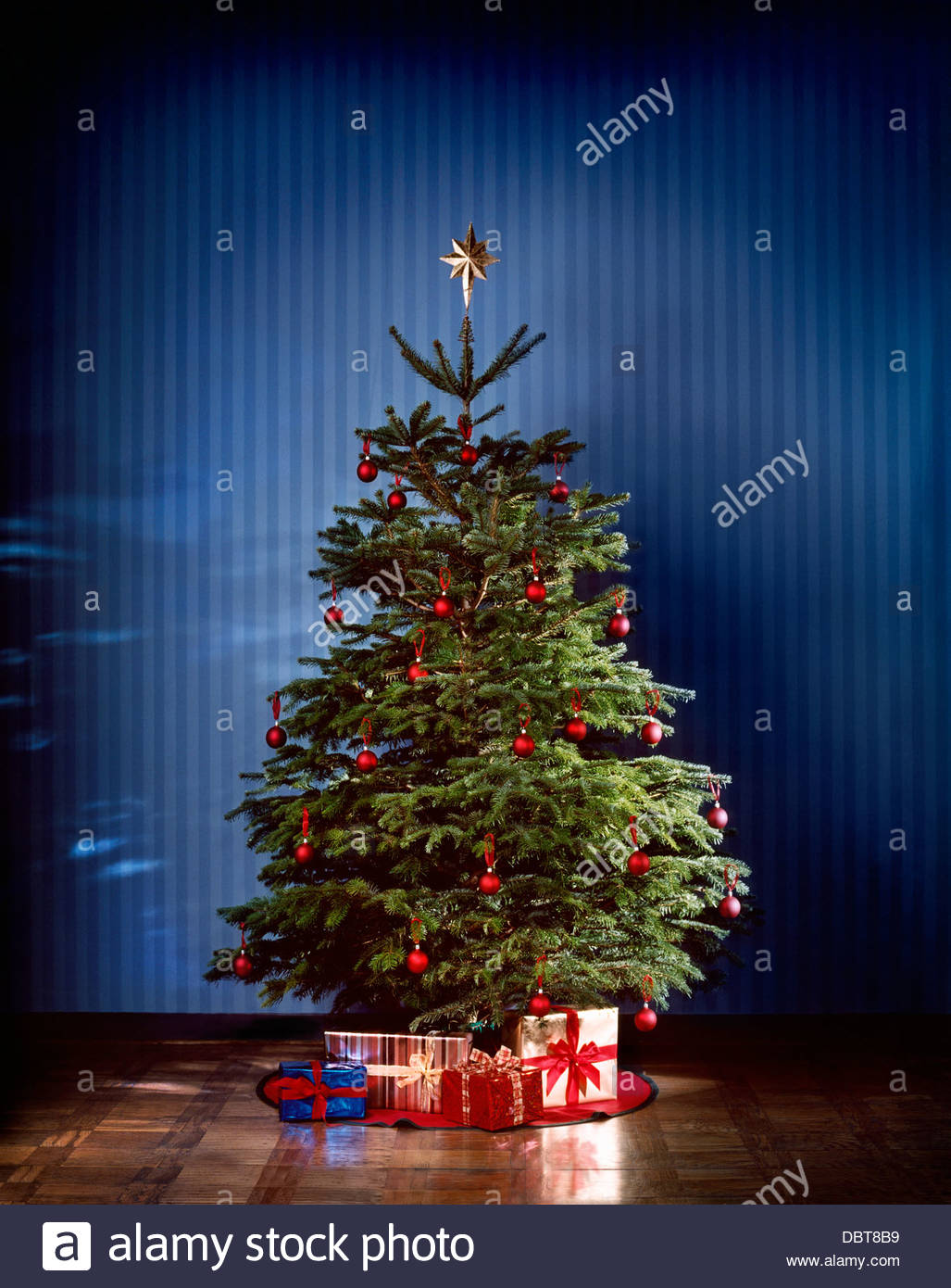 Christmas tree with presents - Stock Image