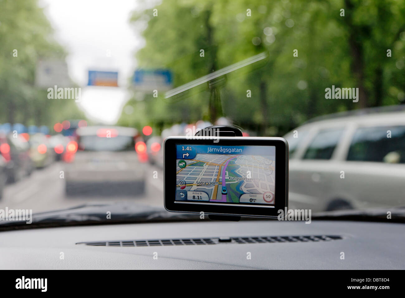 Global positioning system in car in traffic - Stock Image