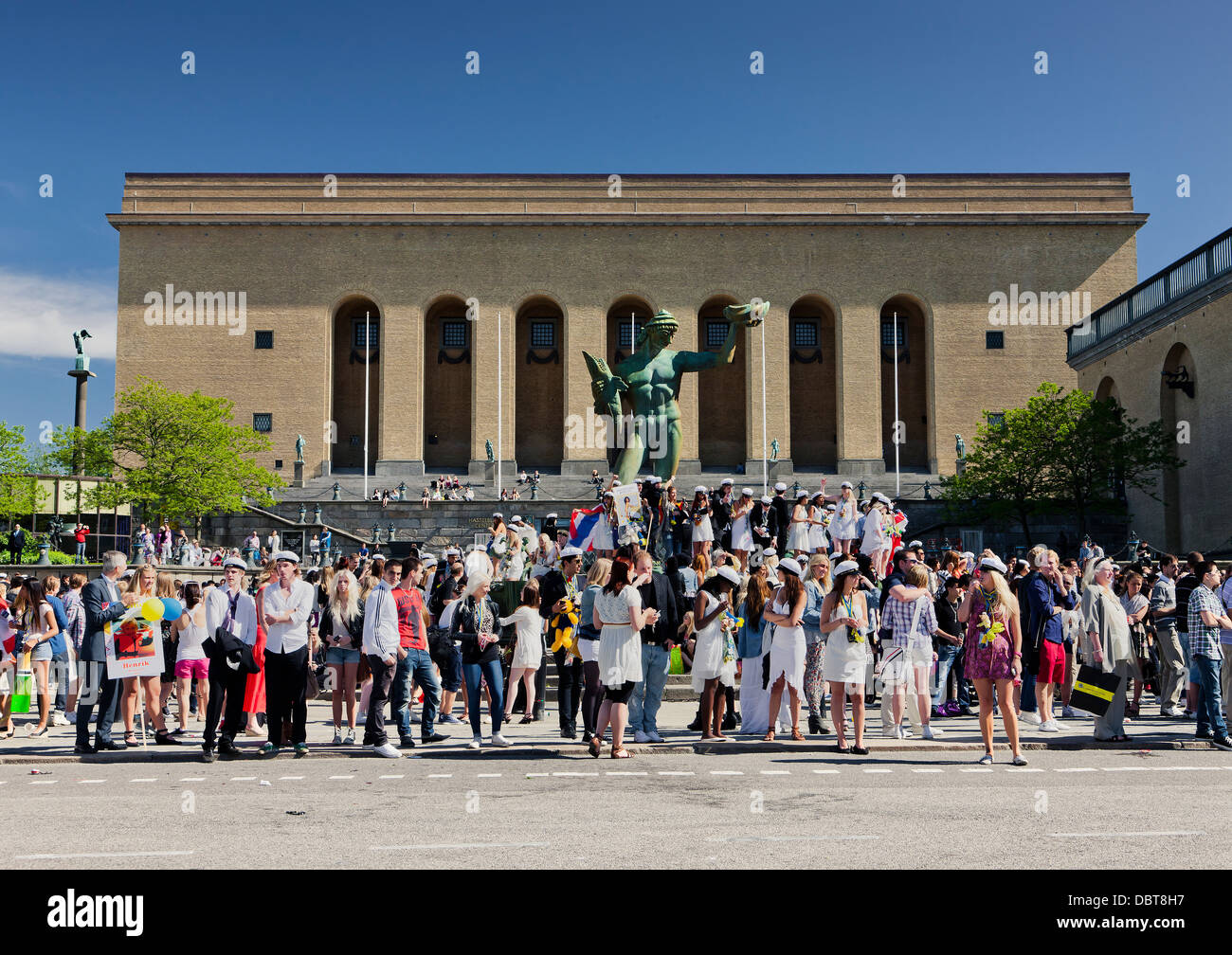 Poseidon statue near art museum surrounded by tourists - Stock Image