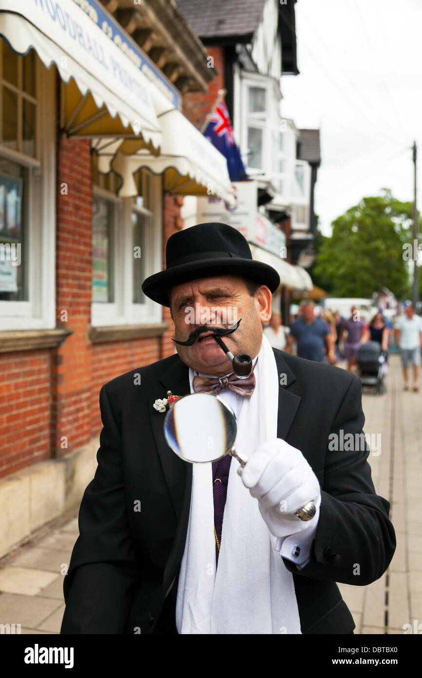 Lincolnshire Village UK England. Man dressed in traditional 1940's outfit of Hercule Poirot investigator with - Stock Image