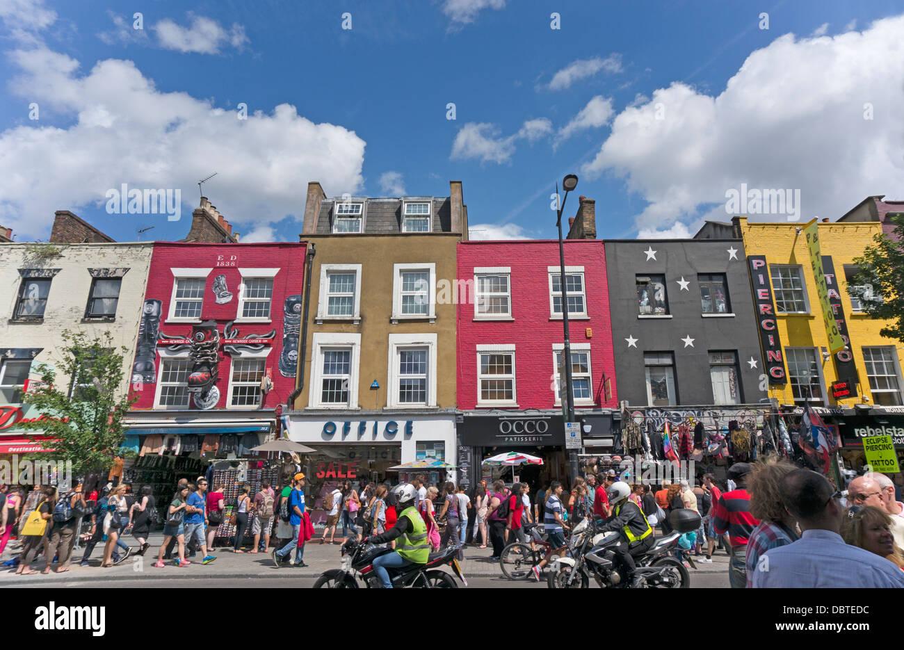 A colourful shopping parade in the summer sunshine, on a busy Camden high street, near Camden Market, London, England, - Stock Image