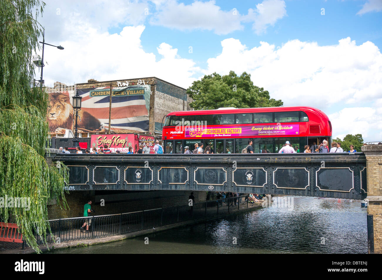 A new-style red Routemaster bus going over Regents Canal bridge, near Camden Market, London, England, UK. - Stock Image