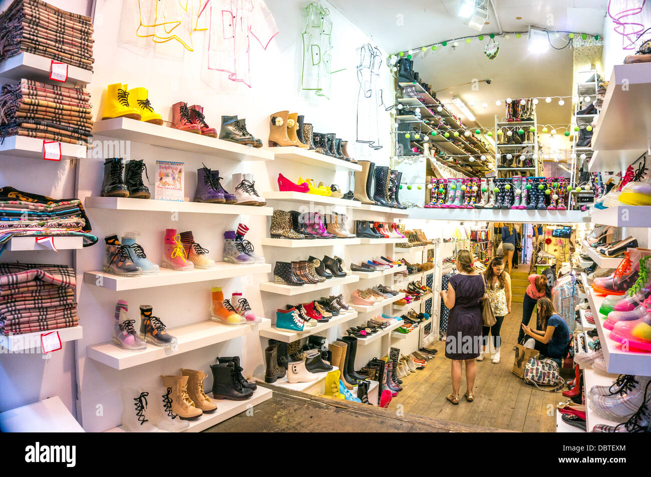 Colourful footwear shop, Camden Market, London, England, UK. - Stock Image