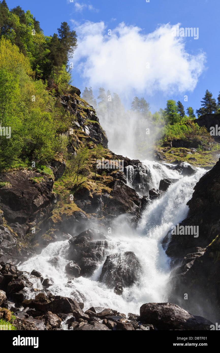 Powerful force of spectacular Latefossen waterfall in early summer near Odda, Hardanger, Hordaland, Norway, Scandinavia - Stock Image