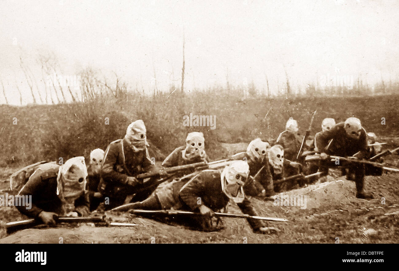 British Infantry advancing wearing gas helmets during WW1 - Stock Image