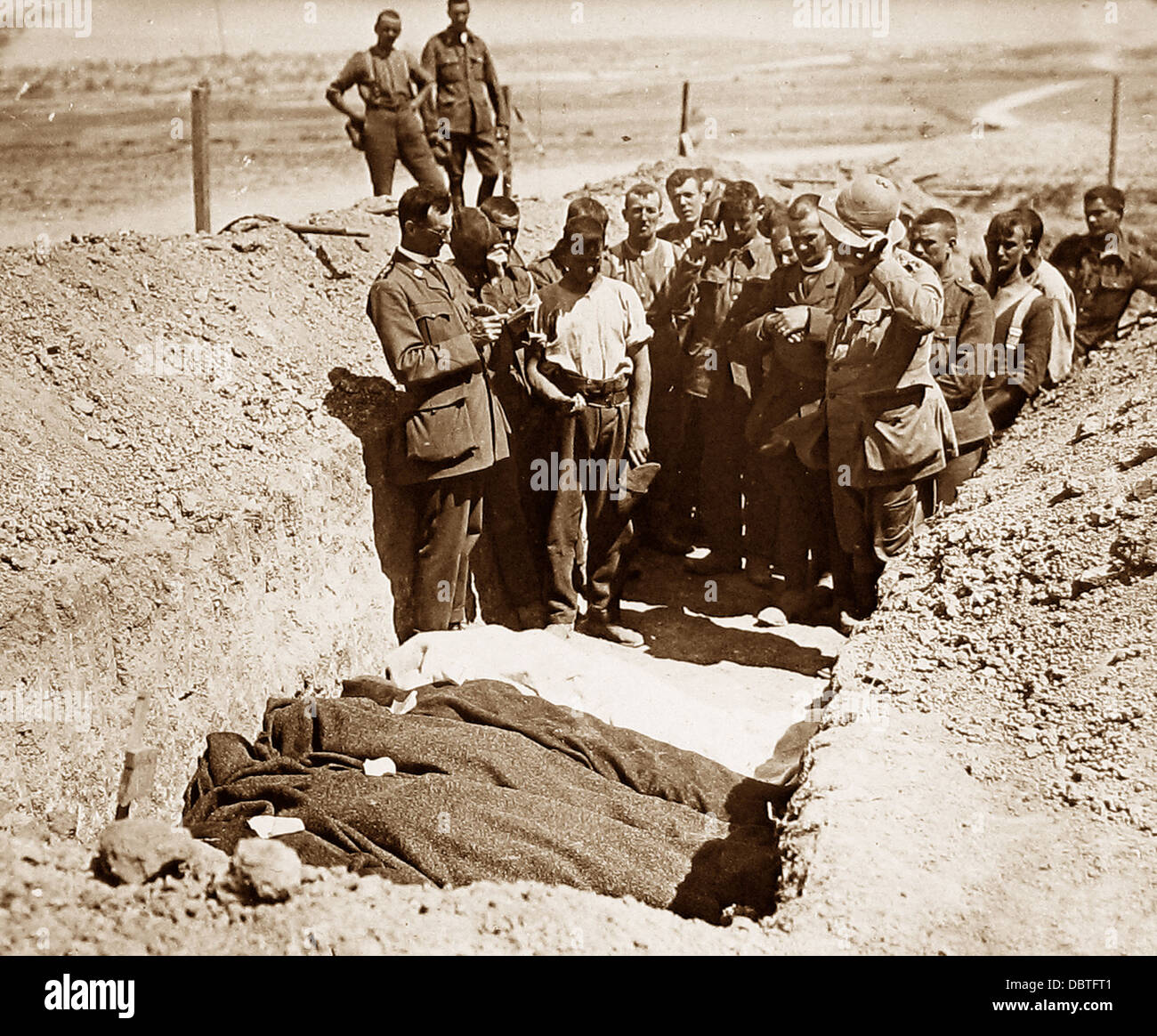 A burial ceremony with Church of England, Roman Catholic and Presbyterian Clergy during WW1 - Stock Image