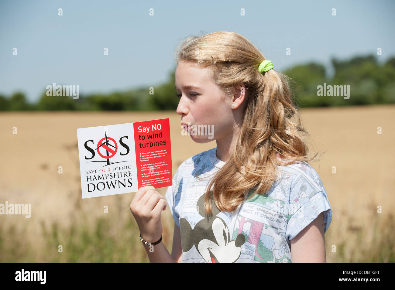 Young wind turbines protester supporting a campaign saying no to wind farm at Hampshire Downs England UK Stock Photo