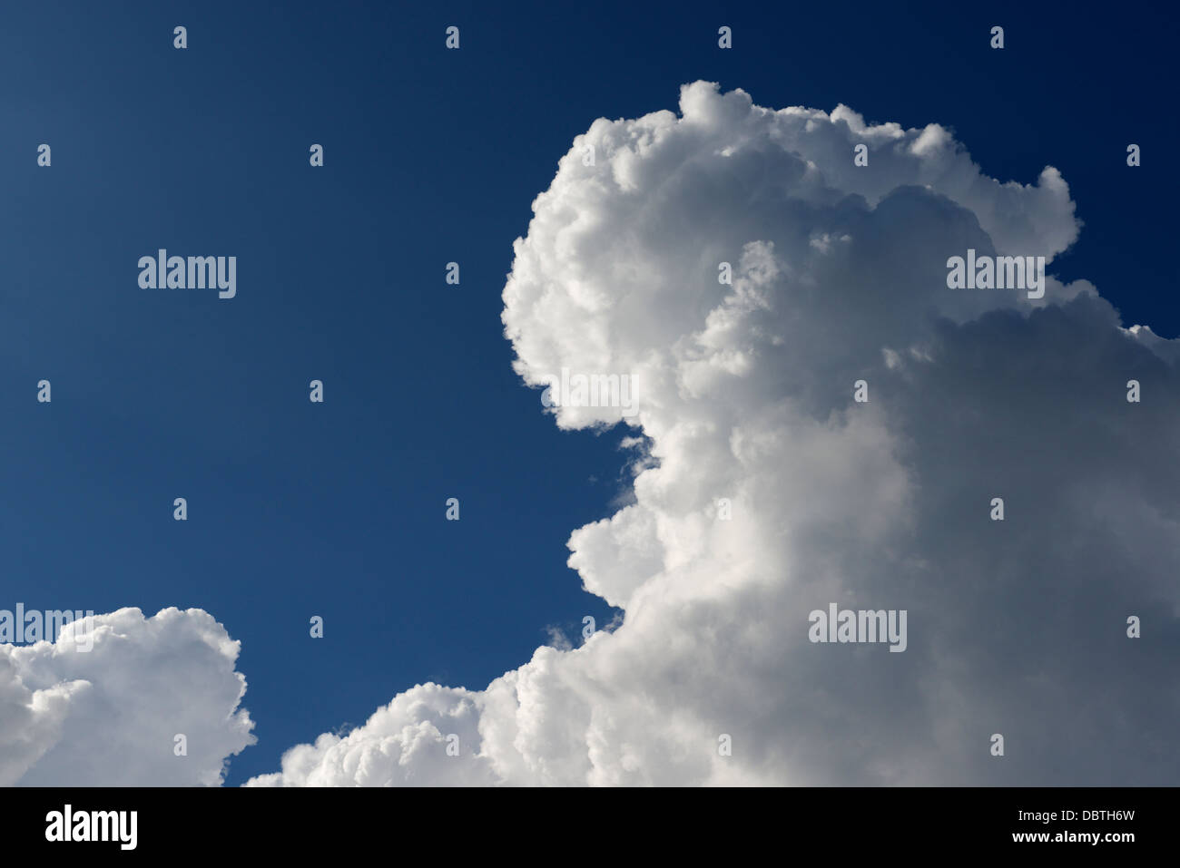 Fair weather cloud over Glasgow - Stock Image