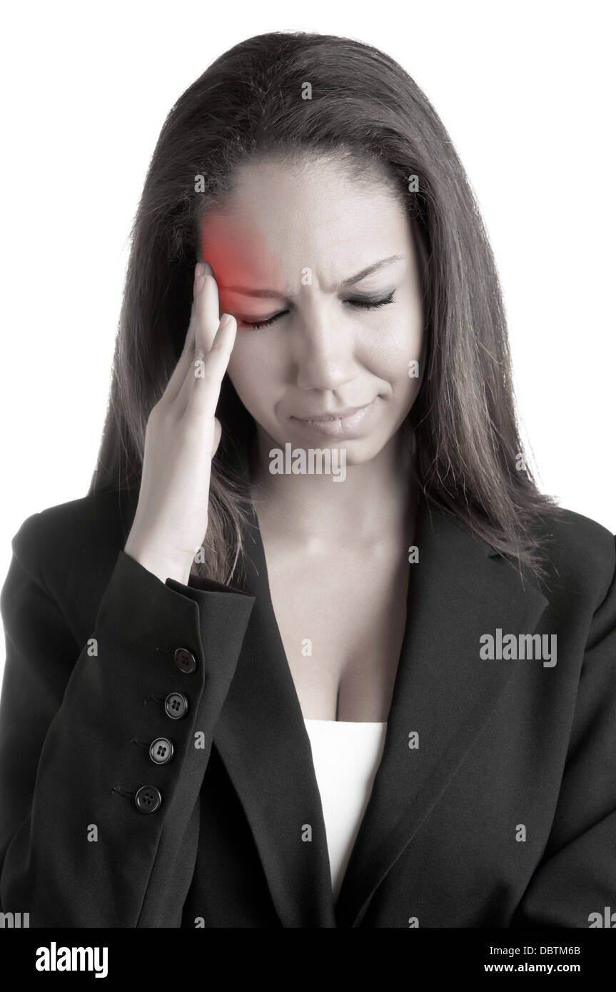 Business woman suffering from an headache, holding her hands to the head, with a red spot around painful area - Stock Image