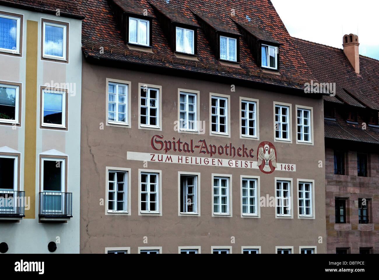 Apotheke - Zum Heiligen Geist 1486 (old chemist), Nuremberg, Bavaria, Germany, Western Europe. - Stock Image