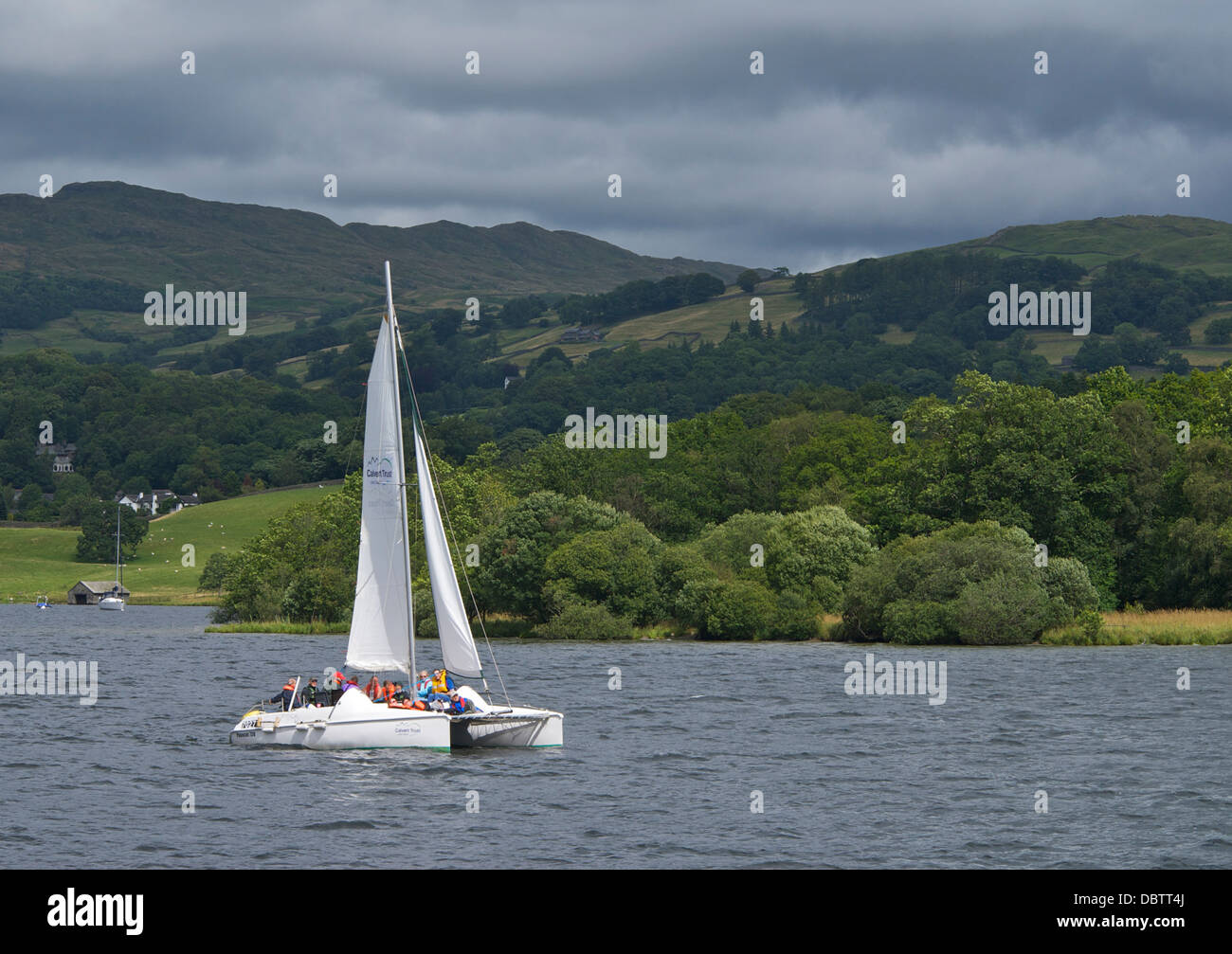 Catamaran on Lake Windermere, Lake District National Park, Cumbria, England UK - Stock Image