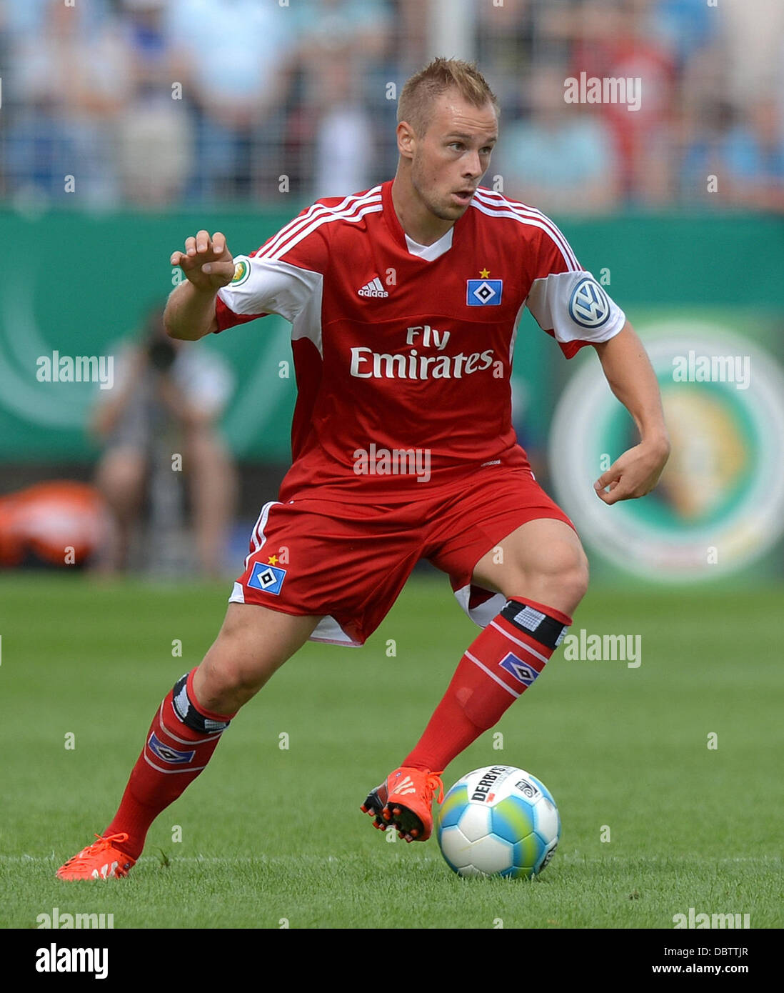 Jena, Germany. 04th Aug, 2013. Hamburg's Maximilian Beister plays the ball during the first round DFB Cup match - Stock Image