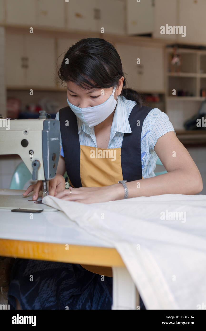 Laotian worker at a small textile production factory outside Vientiane, Laos - Stock Image