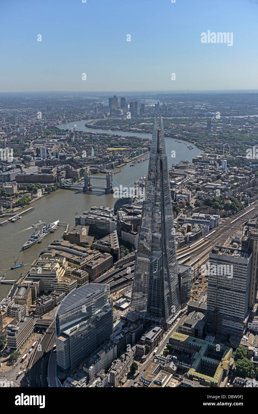 Aerial photograph of London looking from the Shard east along the River Thames with tower bridge and Canary Wharf - Stock Image