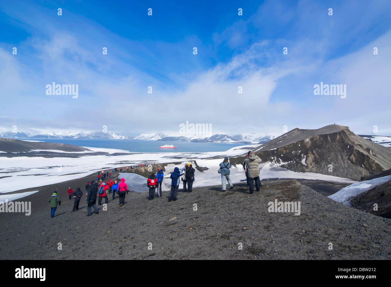 Tourists looking at the Volcano crater at Deception Island, South Shetland Islands, Antarctica, Polar Regions - Stock Image