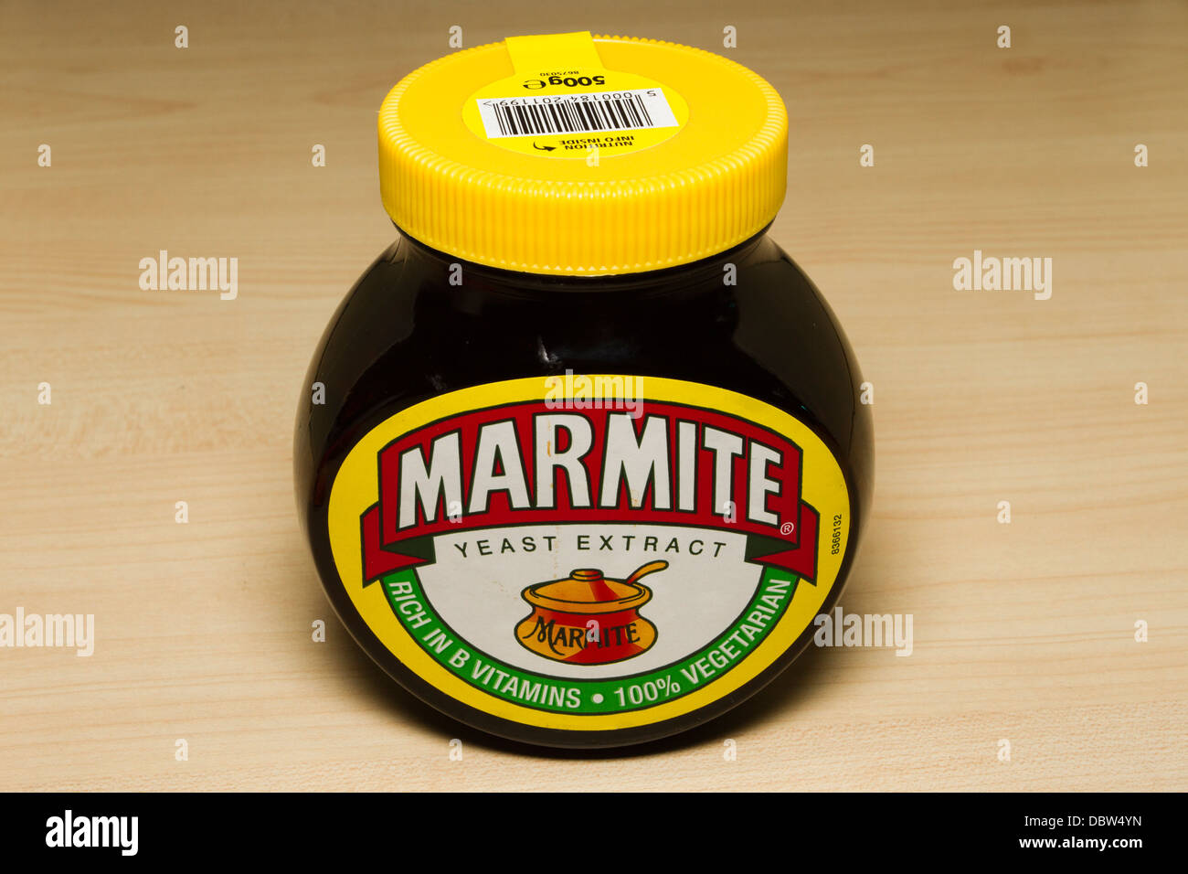 Closed jar of Marmite yeast extract on an empty kitchen table - Stock Image