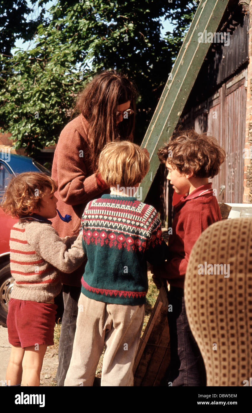 Brothers boys kids playing outside in 1970s Britain in retro vintage clothing Norwich Norfolk 1973  KATHY DEWITT - Stock Image