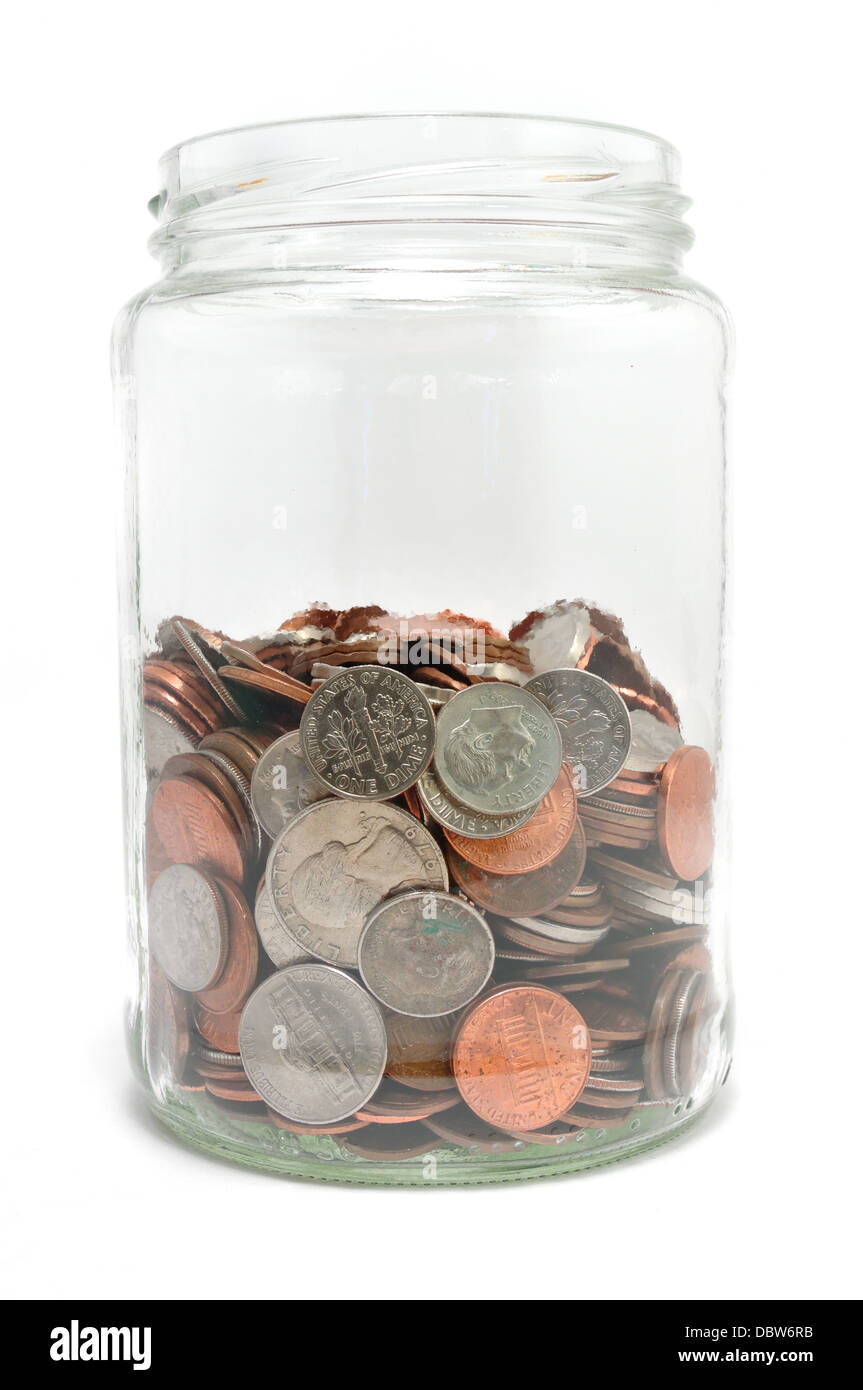 US coins in a glass jar on white background - Stock Image