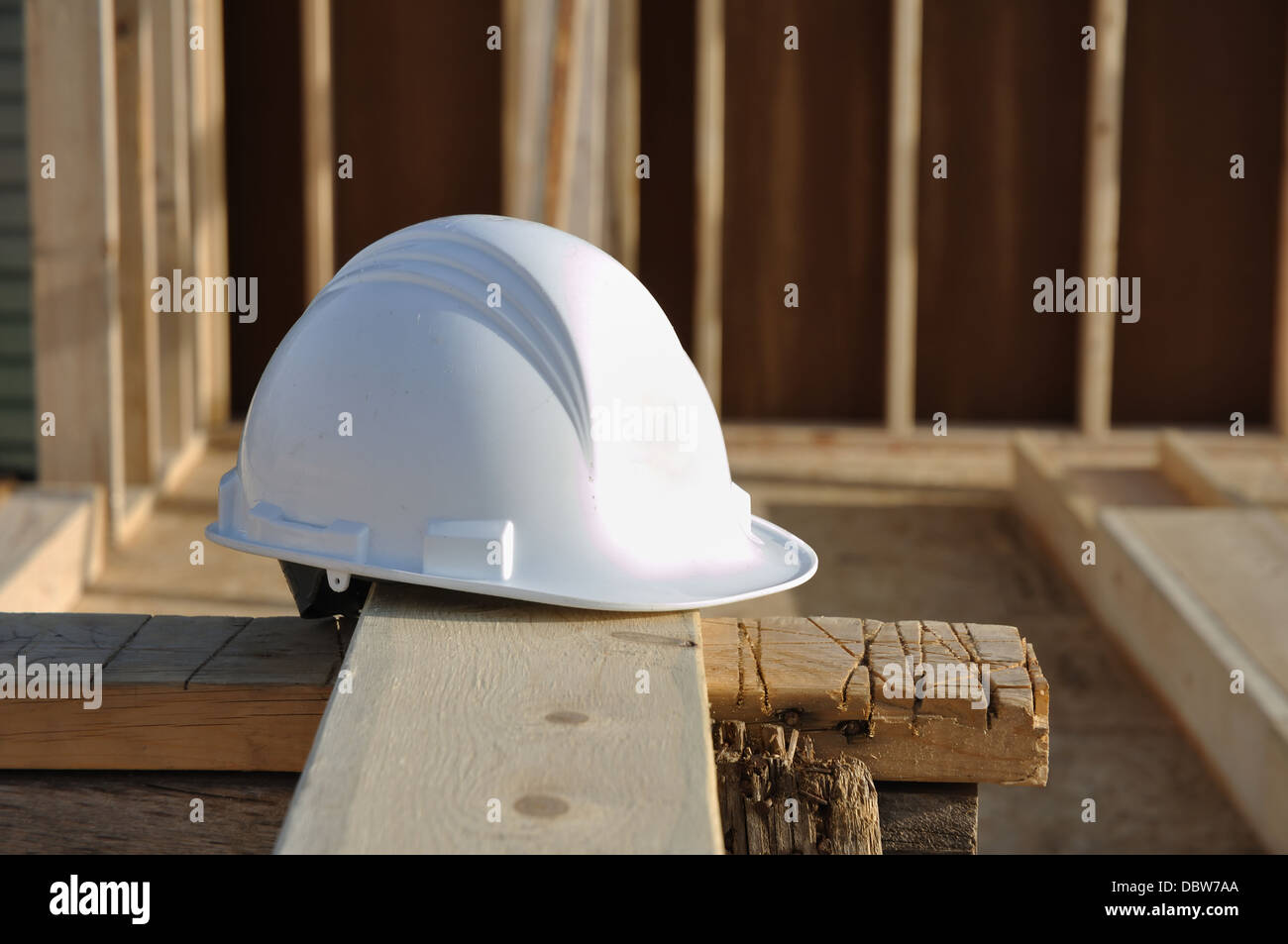 Hard hat safety helmet on a construction site, building site - Stock Image