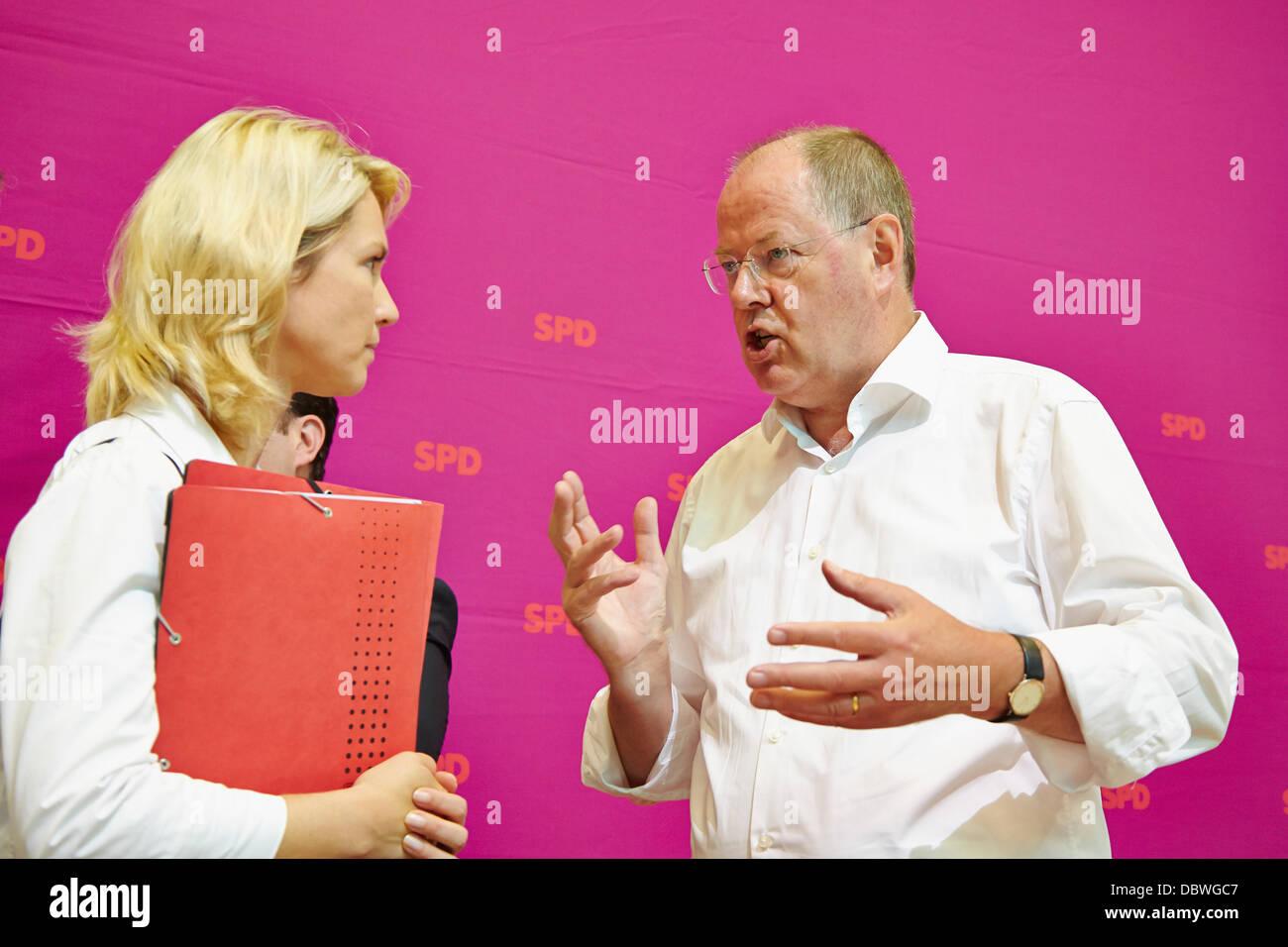 Berlin, German. 5th Aug, 2013. Peer Steinbrueck (SPD), SPD chancellor candidate, talking to Manuela Schwesig (SPD), - Stock Image