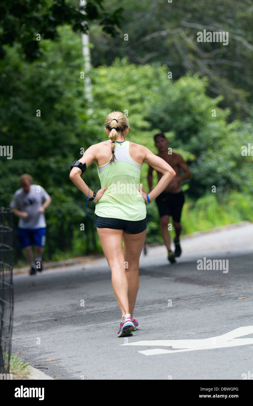 Woman exercising in park Stock Photo