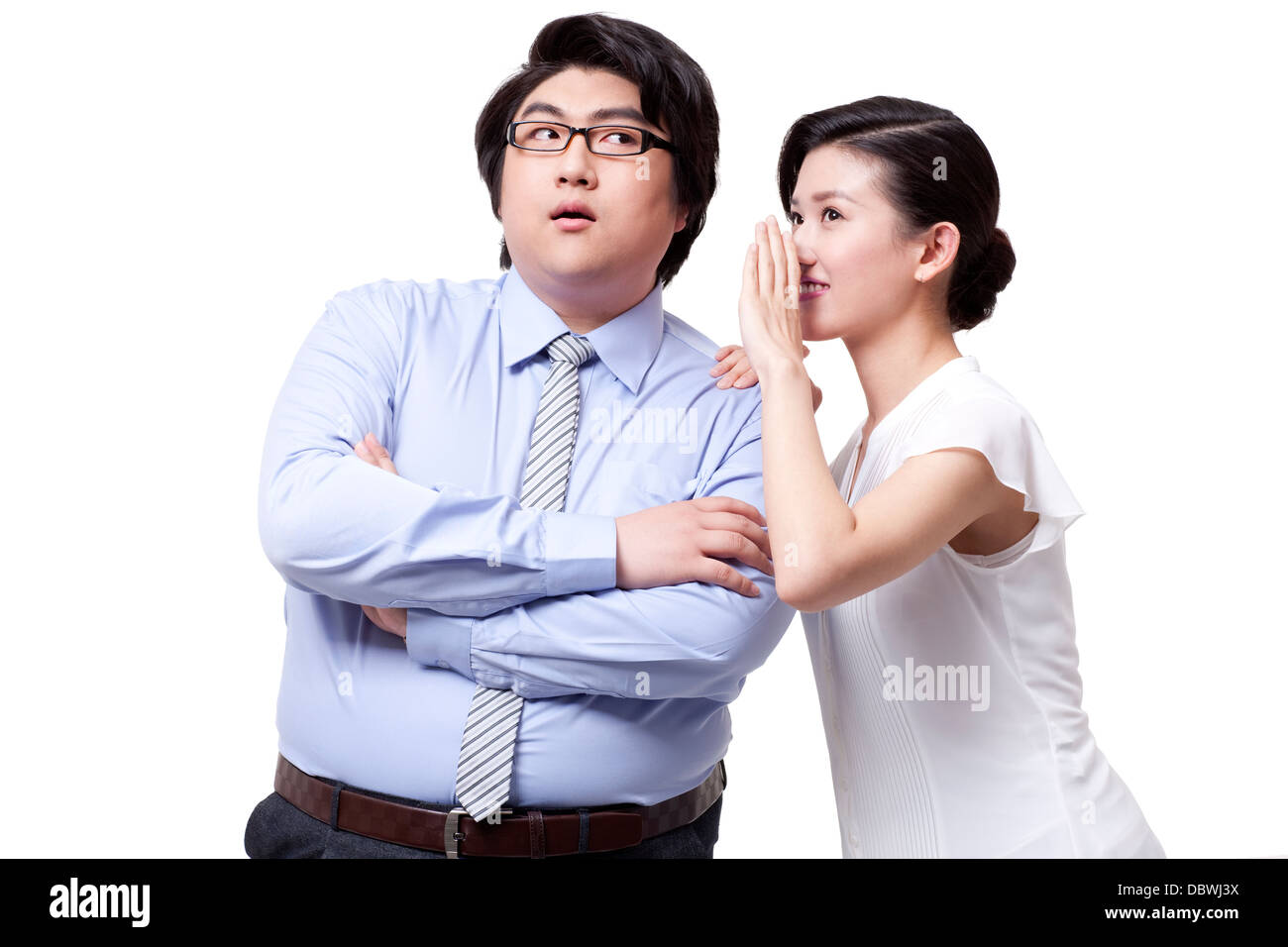 Business partner talking in secret - Stock Image