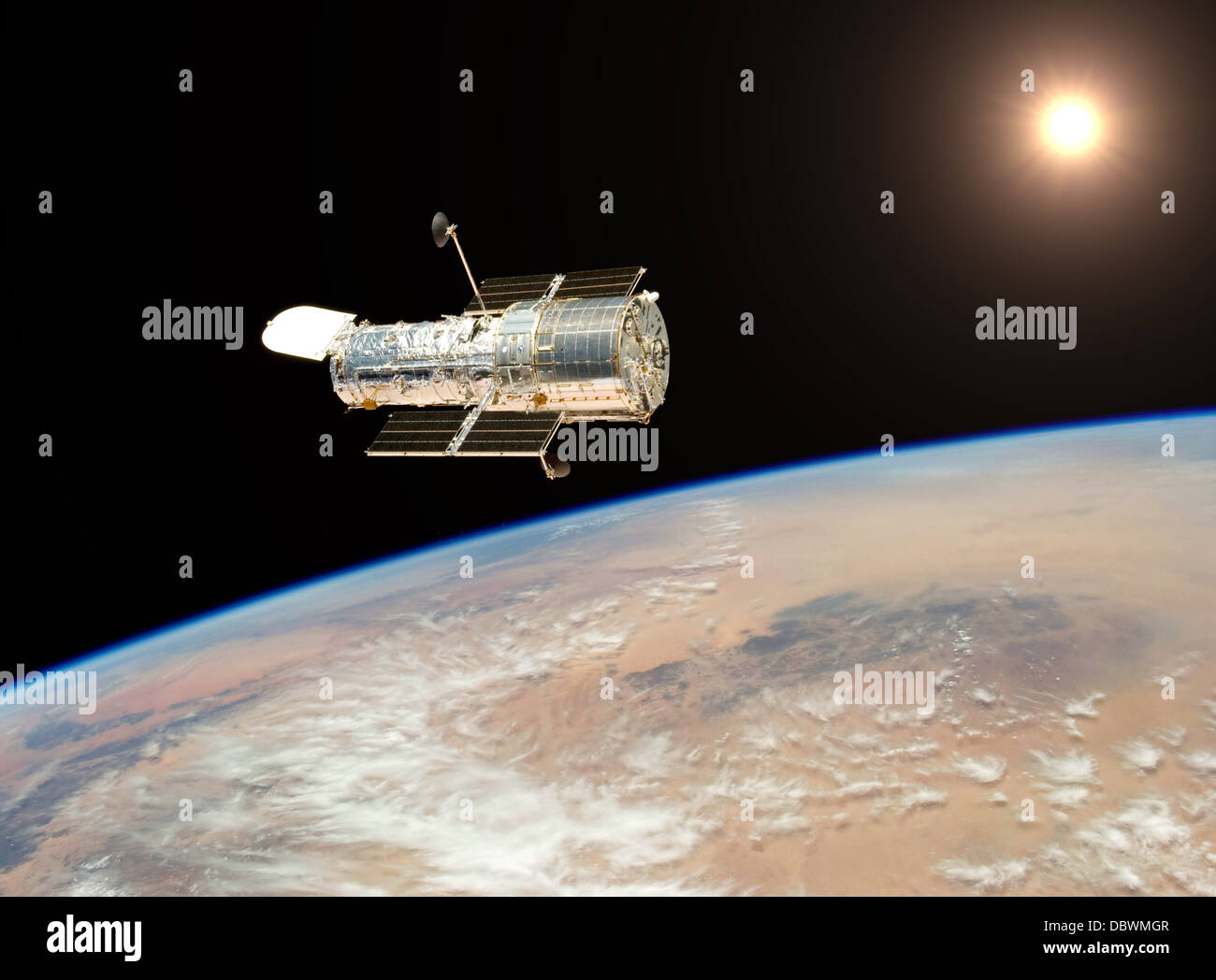 Hubble telescope hovers 350 miles above earth photographing for space exploration - Stock Image