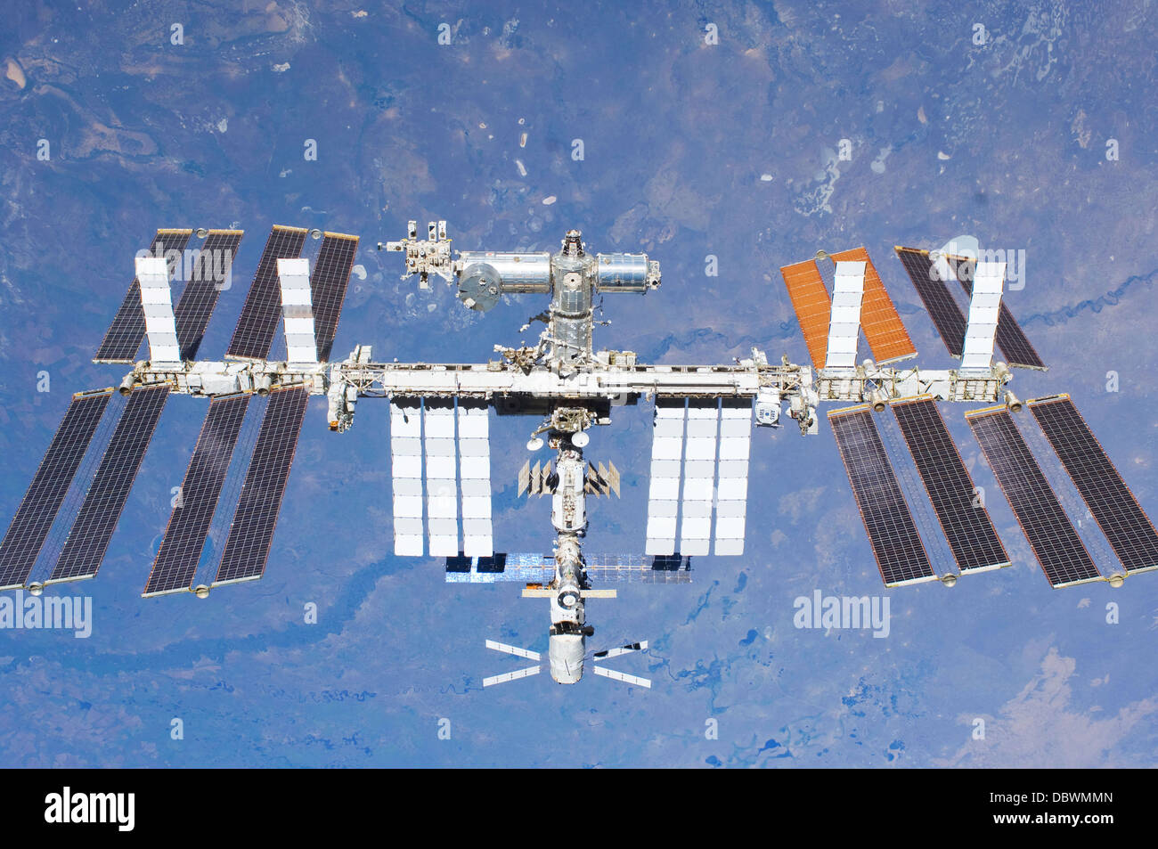 NASA image of International Space Station (ISS) flying above earth - Stock Image