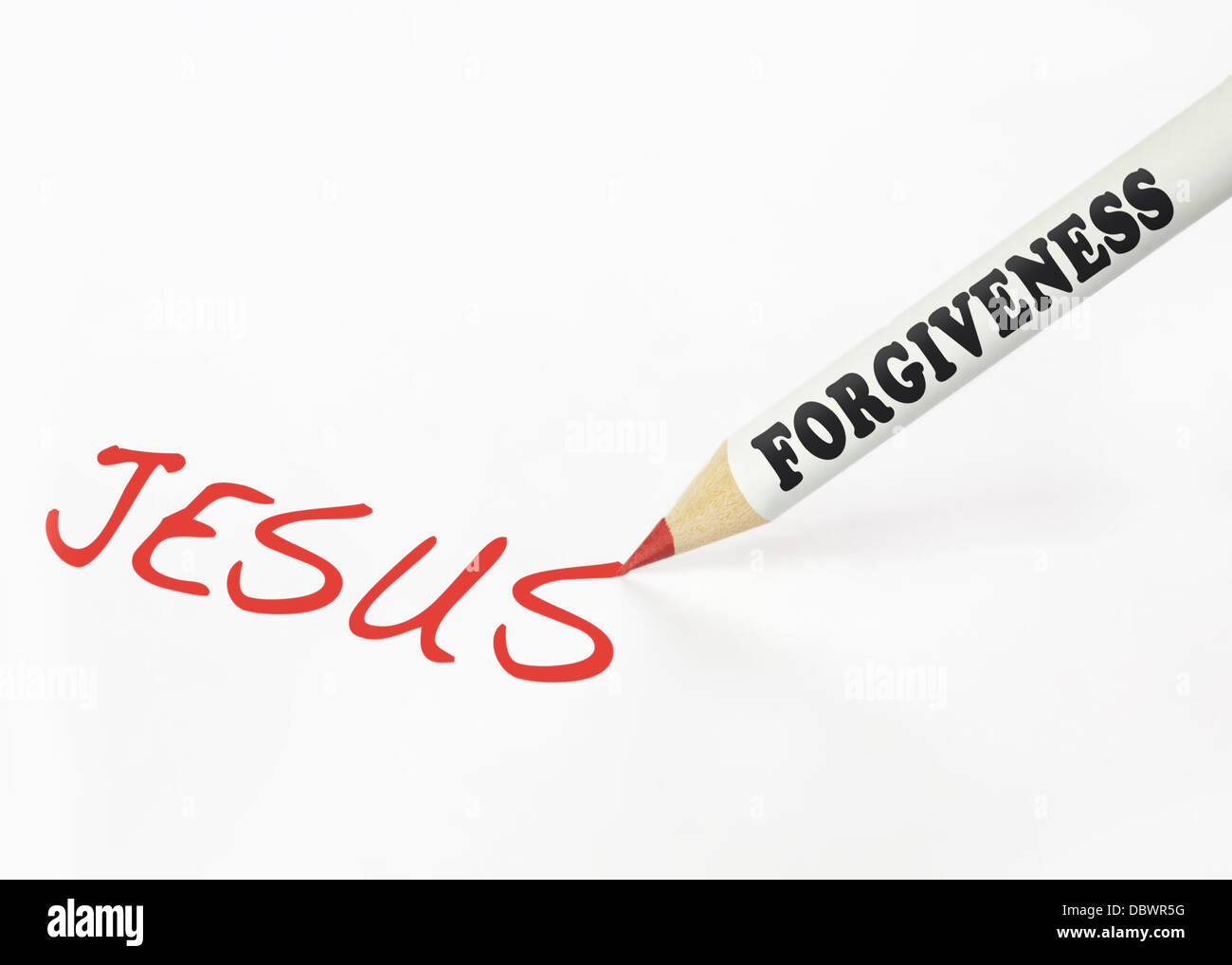 A forgiveness labeled pencil writing the word Jesus - Stock Image