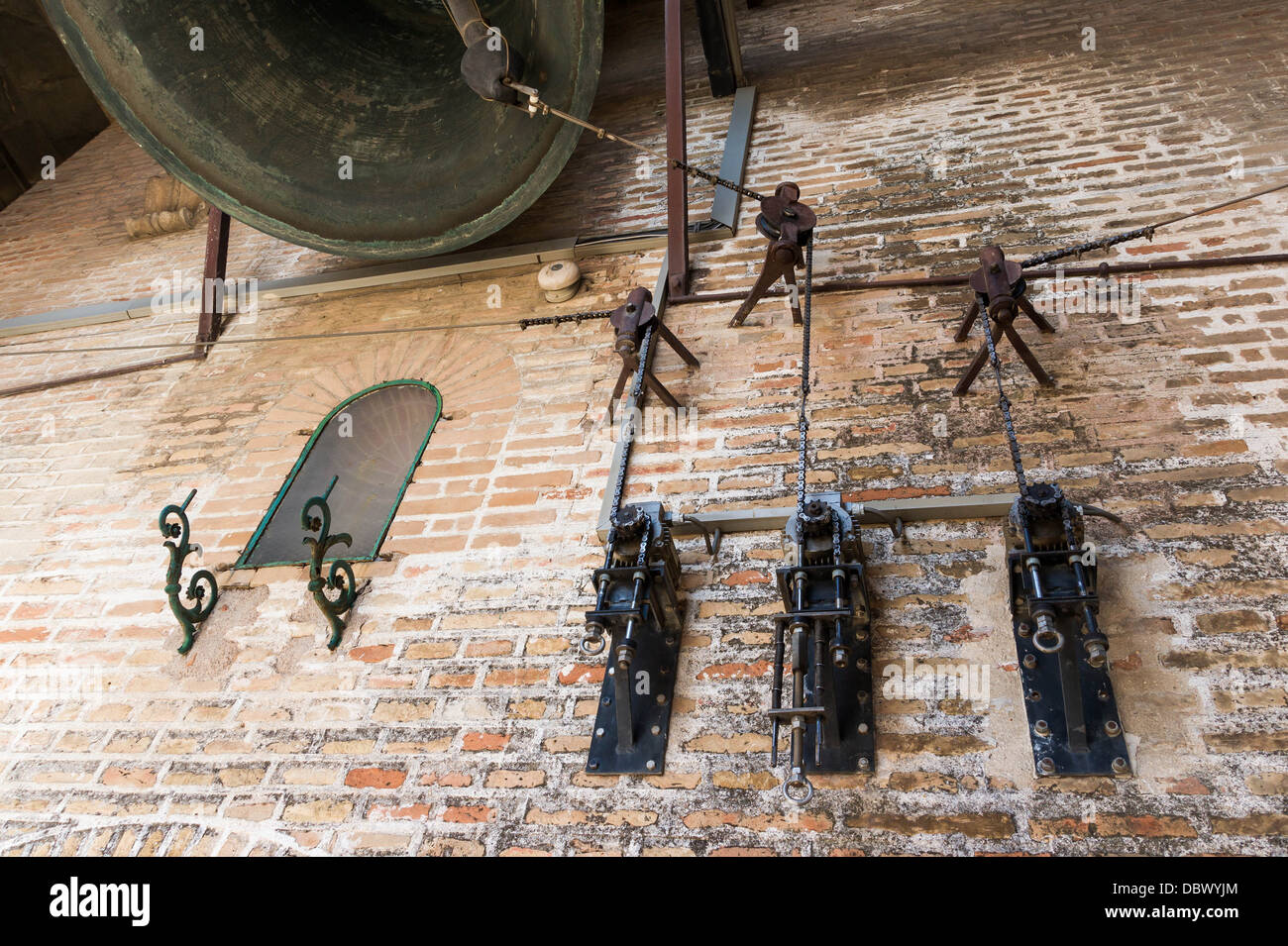 How to ring bells with electric motors, Giralda tower, Seville, Spain. - Stock Image