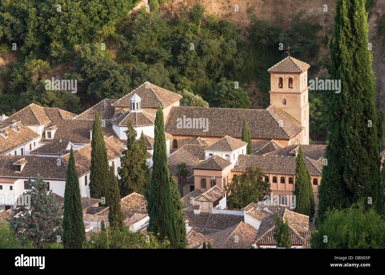 Roofs on the 'Carrera del Darro', among them, the roofs of church San Pedro y Pablo, Granada, Spain. - Stock Image