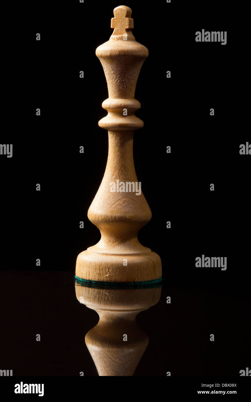 Chess king isolated on black with reflection - Stock Image