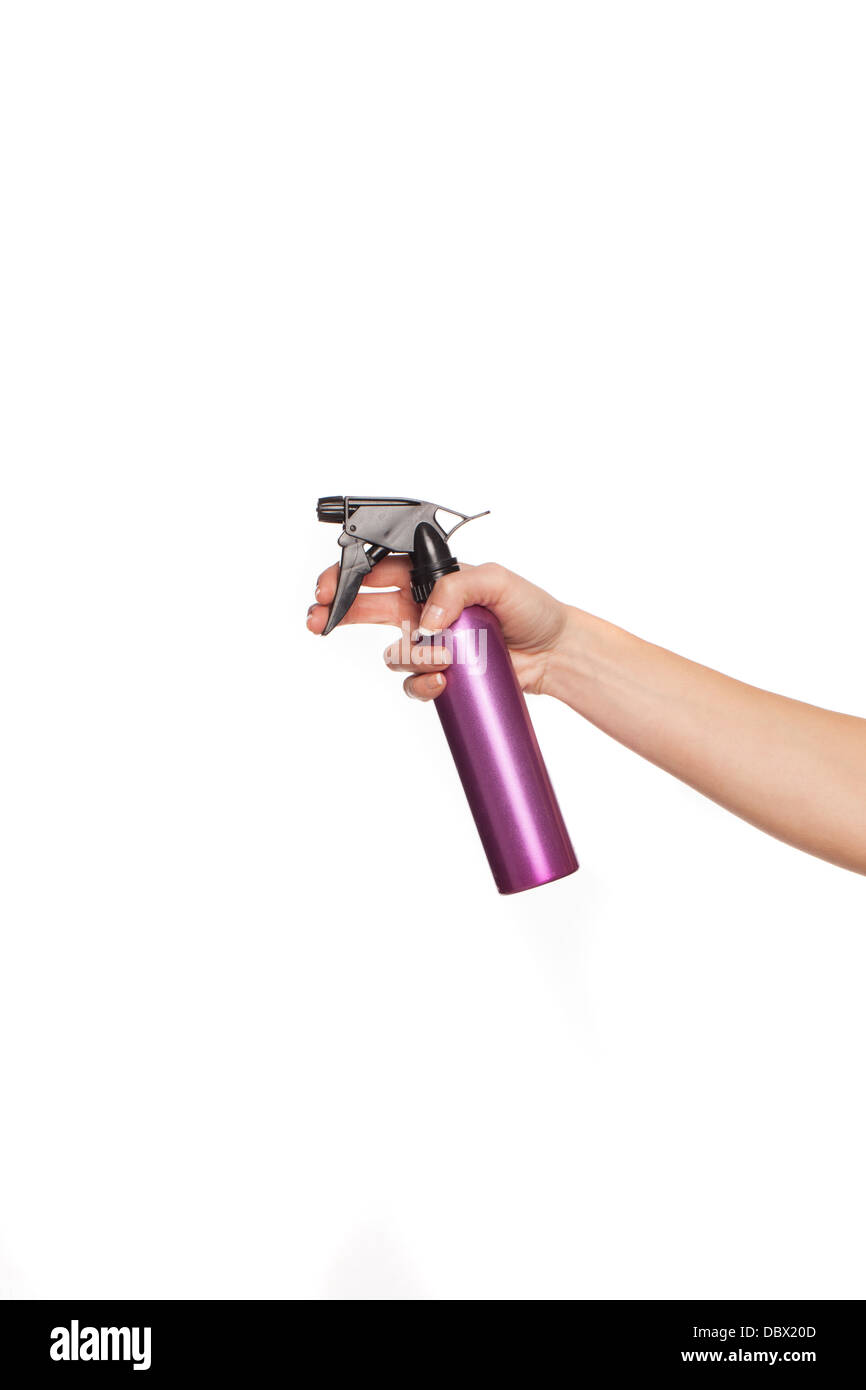 Female hand holding a spray can Stock Photo