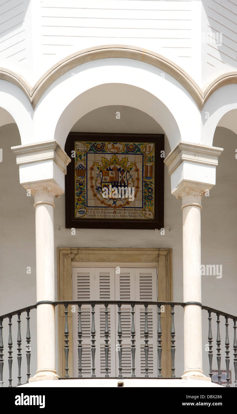 Detail of the balcony of the seat of the Real Maestranza de Caballeria, with an enameled plaque with the CoA (variant) - Stock Image