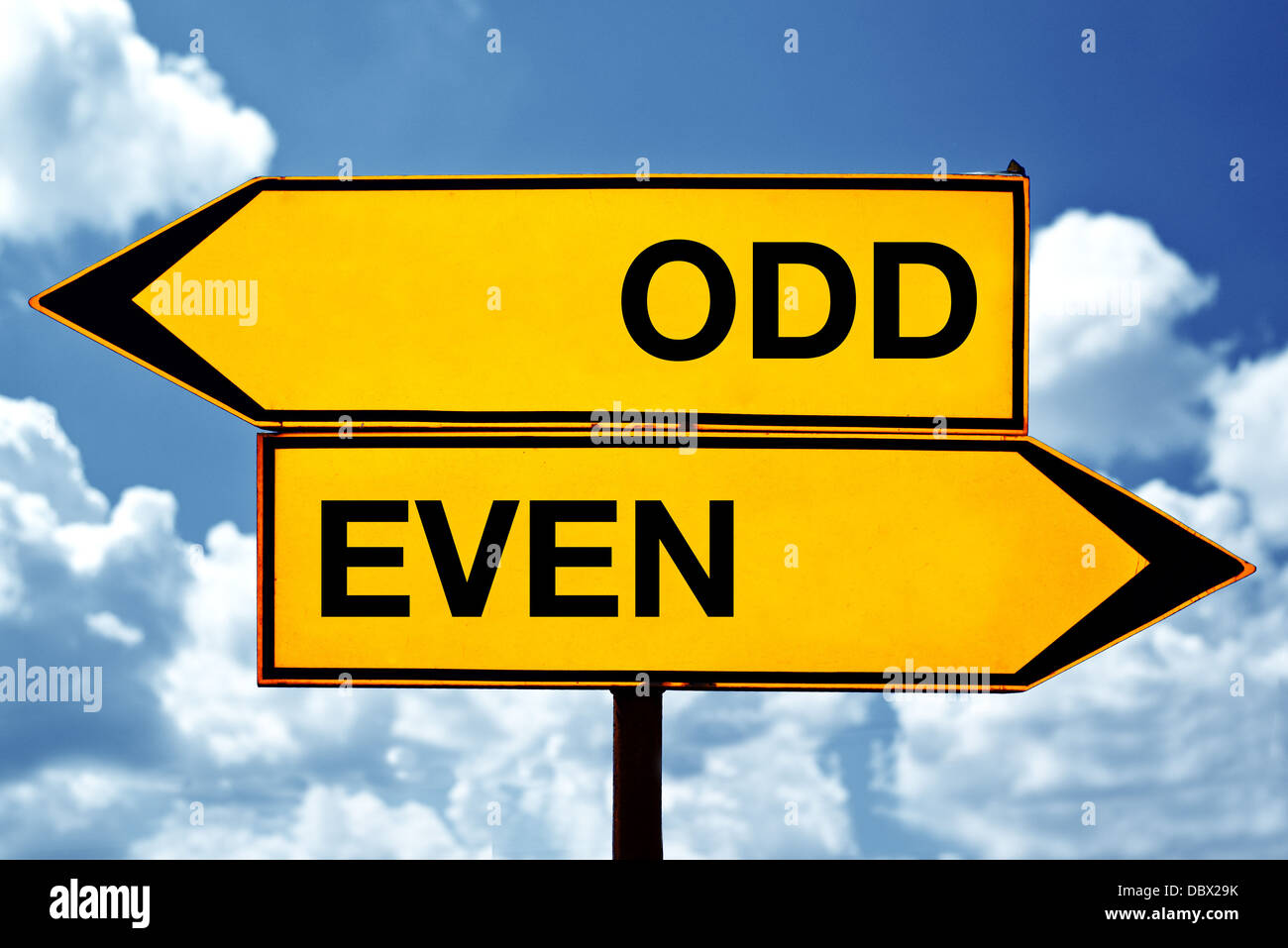 Odd or even, opposite signs. Two opposite signs against blue sky background. Stock Photo