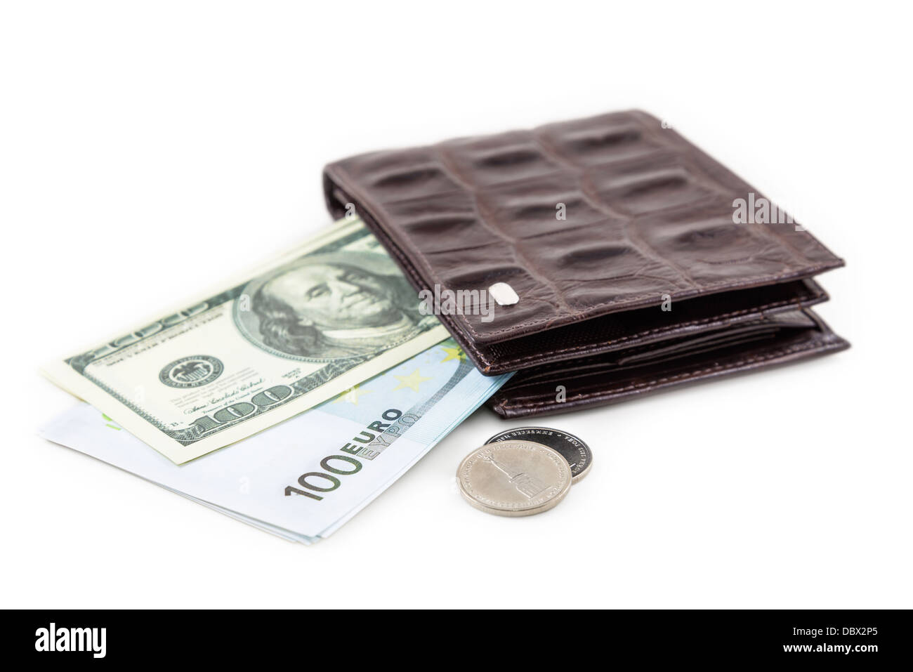 The brown leather wallet with euro and dollar is photographed on the close-up - Stock Image