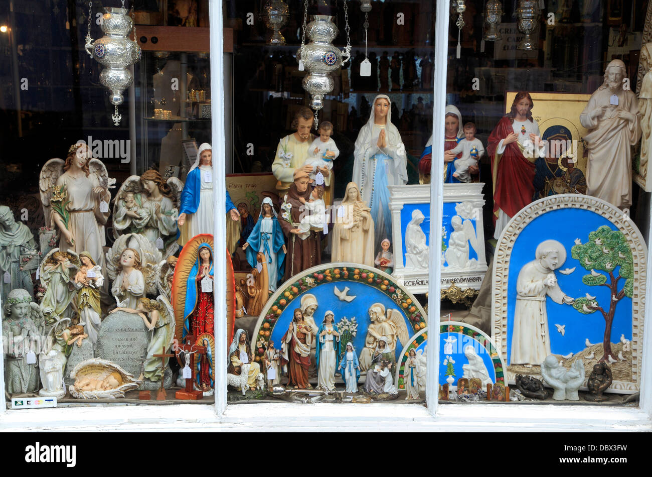 Walsingham, Pilgrim Shop, detail of religious icon icons church accessories in window crucifix, Norfolk, England - Stock Image