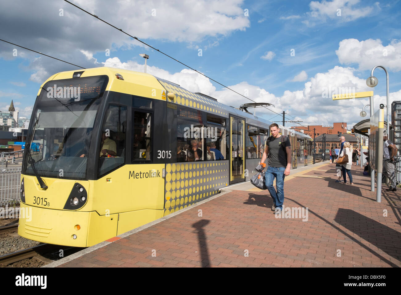 Metrolink tram to East Didsbury at Deansgate-Castlefield station in Manchester city centre, England, UK, Britain - Stock Image