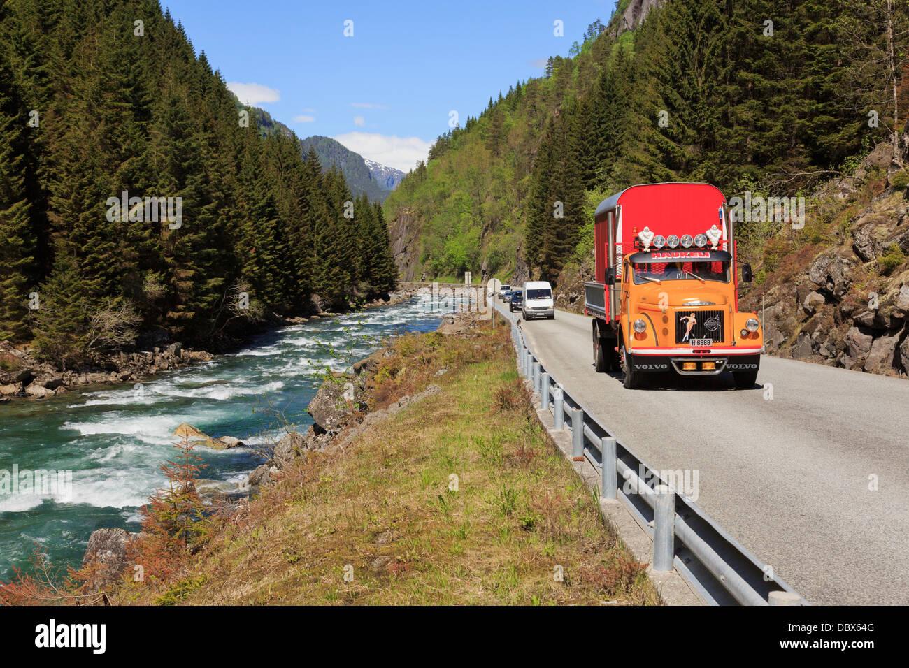 Volvo truck on narrow mountain road 13 through river valley near Odda, Hardanger, Hordaland, Norway, Scandinavia - Stock Image