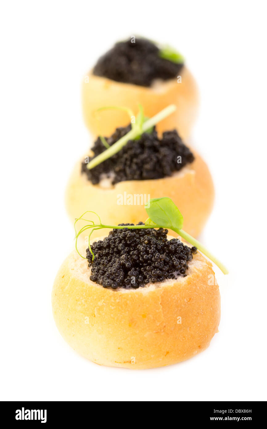 canape with meat seafood and black caviare - Stock Image
