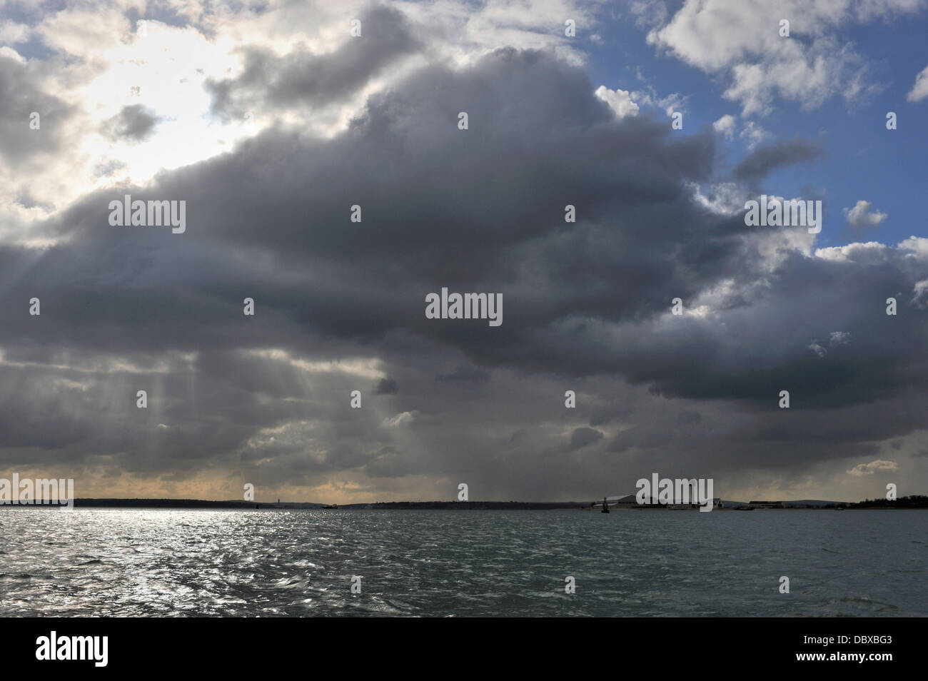 Cumulonimbus clouds over the Solent, Hampshire, England UK - Stock Image