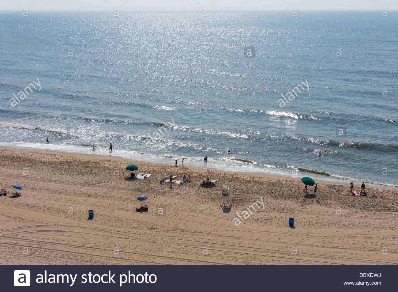 Vacationers stake out positions on the early morning beach in Ocean City, Maryland. - Stock Image
