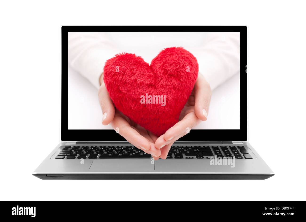 Laptop with red heart in woman hands. Clipping path included. - Stock Image