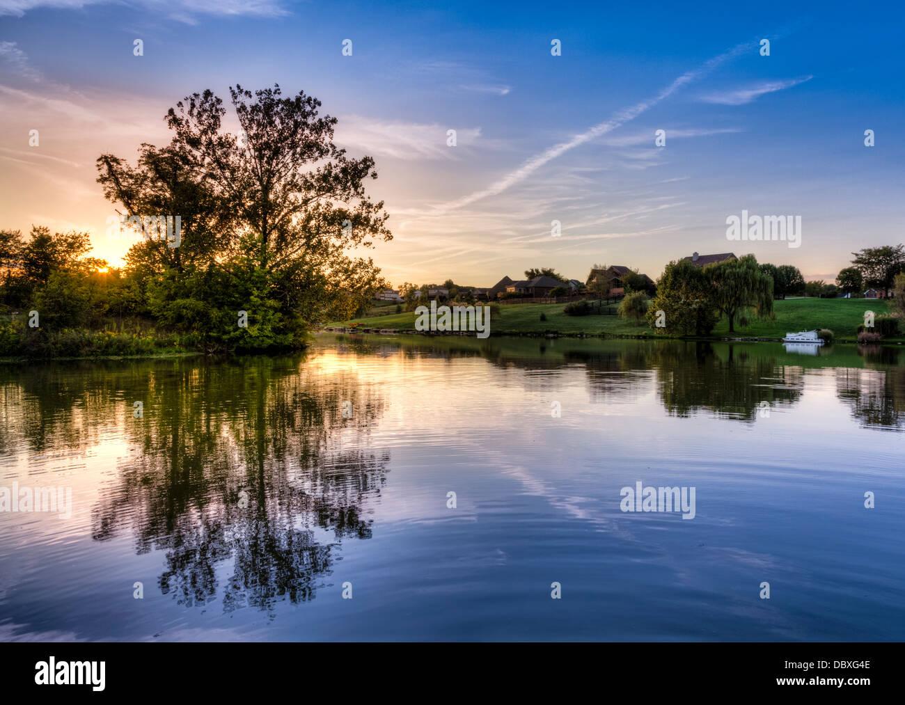 Sunset on a lake - Stock Image