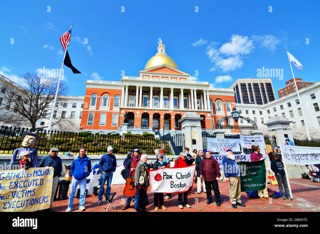 BOSTON - APRIL 6: Protestors at Massachusetts State House April 6, 2012 in Boston, MA. The building was completed - Stock Image
