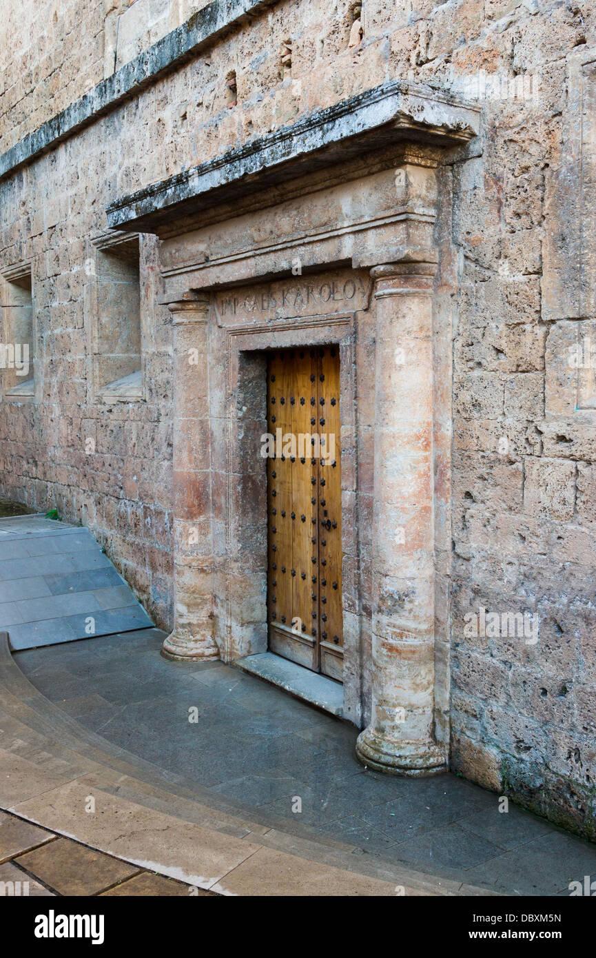 A lateral entrance to the 'Palacio de Carlos V', (IMP.CAES.KAROLO.V.), Alhambra, Granada, Spain. - Stock Image